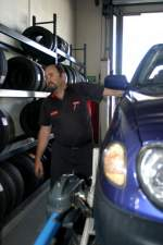 ANDREW SIMMONDS DOING A WHEEL ALIGNMENT